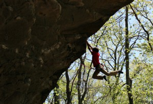 William dangles from a cliff during a challenging climb. Photo: William Pair