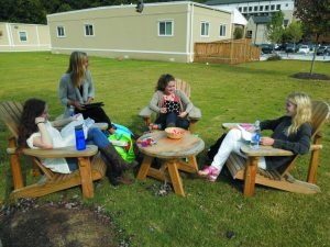 Seniors enjoy their free time in the green space.