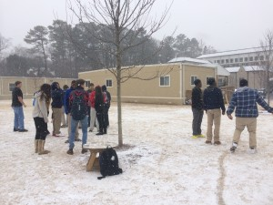 Sophomores threw snowballs, made snow angels, and shoved the ice down each other's shirts as the snow started to stick to the grass. Photo: Dean Papastrat