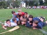 "Overjoyed Freshman dog-pile on top of Graham ""G-Bo"" Hurley  during bonding activities Credit: Sara Eden"