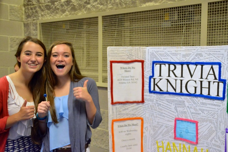 Seniors Lacey O'Sullivan and Hannah Kelly promote the popular club Trivia Knight Photo: Ryan Vihlen