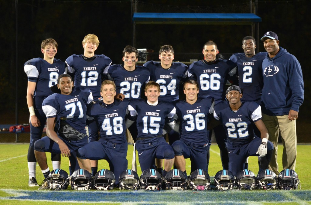 Senior football players, Class of 2014, are all smiles after their win over Mt. Vernon last year. Photo: Fred Assaf