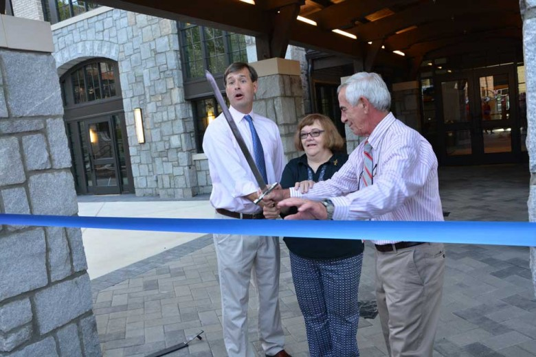 Mr. Gannon, Ms. Smith, and Mr. Owens cut the ribbon to open the new Arthur M. Blank Family Upper School.  Photo: Lee Wilson