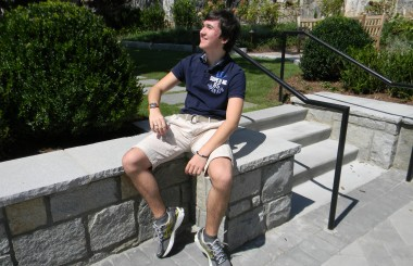 Junior Max Sharpe admires his new school from the gardens. Photo: Julia Beck