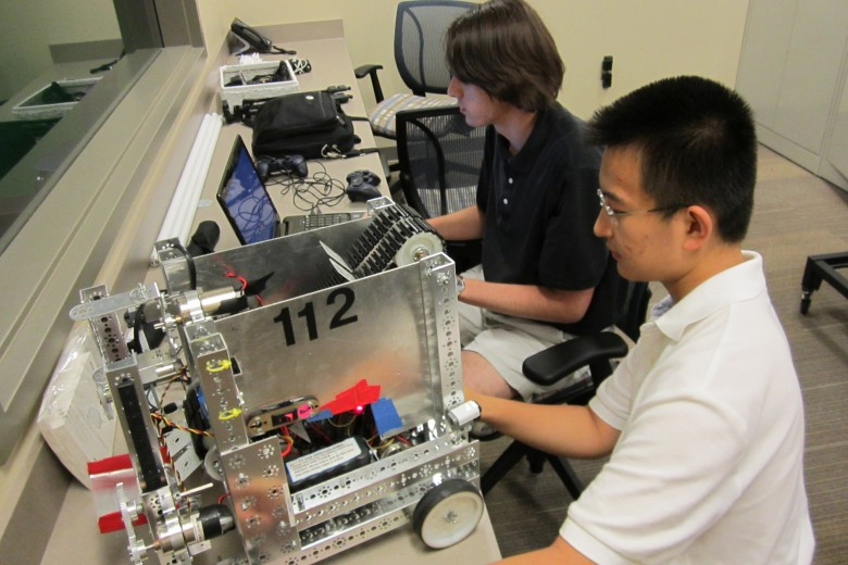 Senior Jonathon Spalten and junior Andrew Wu work on the drive train of the robot. Photo: Rohan Malik