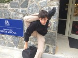 Luke Moussa contorts in front of the Middle School Photo Creds; Eno Reyes