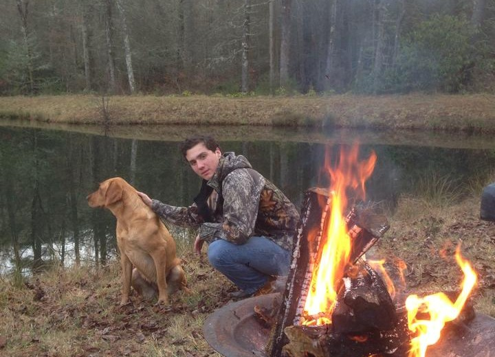 "Sophomore Ben ""Big-Bon"" Adair poses on his farm with his trusty mutt Beans during Winter Break  Credit: Ben Adair"