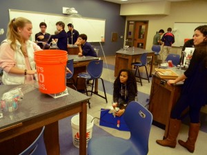 Sophomores Keely Harris, Tahirih Williams and Sophie Zelony aim their water spout in Mr. Hattori's Hydraulics class.