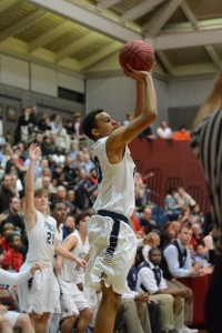 Freshman guard Caleb Holifield hits the go-ahead shot as the Knights' bench looks on. Phot by Fred Assaf