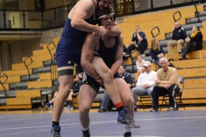 Junior Jack Walsh takes down his opponent.  Photo: Fred Assaf