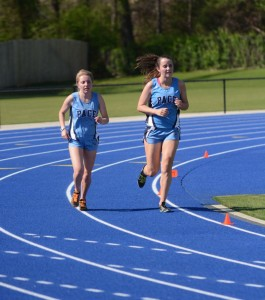 Seniors Katie Nelson and Hannah Kelly race to finish line in the first ever track meet at Walsh Field. Photo: Fred Assaf