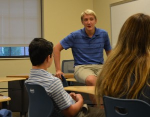 (photo: Sarah Kitchen) Leader Jake Jenkins discusses ways to help the environment