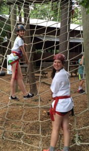 Freshman Gillian Weitzner and Senior Mary Stuart Gray take on the ropes course. Photo: Caitlin Jones