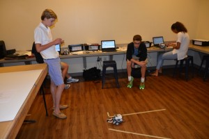 Juniors Alex Kaye and Connor LaMastra focus on the details of their robot in Room 101. Photo by Jordan Harris.