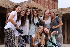 Photo: France Dorman Caption: Upperclassmen girls share a smile outside of a fortress in India. Quoted: Sari Leven, Michael Chen, and Neil DeRosa
