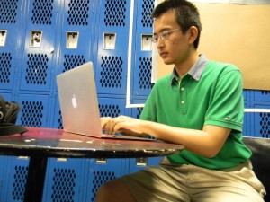 Senior Andrew Wu researches information for his astrophysics book. Photo: Conor Pelletier