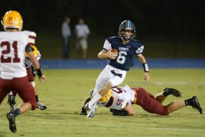 Sophomore QB Gunnor Faulk uses his mobility to gash the Golden Bears for a big gain on the ground. Photo Credit: Fred Assaf