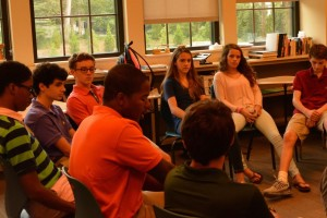 Freshmen listening to their Peer Leader, senior Jean Luc Brown. Photo: Zack Kaminsky