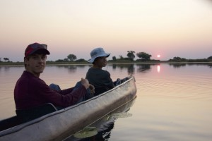 Juniors Max Irvine and Brennan Murphy watch a sunset in a mokoro canoe. Photo credit: Trish Anderson