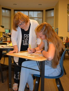 Ms. Smith assists student Megan Walsh Photo: Alyse Greenbaum