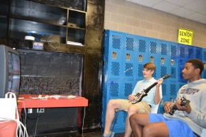 Seniors Bailey O'Sullivan and Spencer Hemmingway duel it out in a classic match of Guitar Hero in the Senior Cellar. Photo by Jordan Harris.