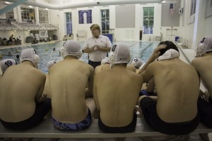 The Water polo team receives a pregame speech from Coach Ague Credit: Laura Inman