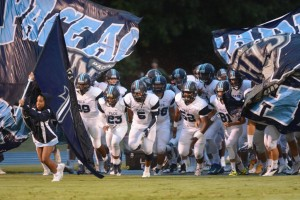 The Pace Football Knights charge the field. Photo: Fred Assaf