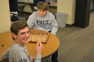 Sophomores Eli Asher and Chris McCaffrey begin another match of chess Photo: Jonathan Rushton