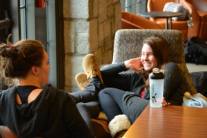 Seniors Darby Cochran and Grace Ferry enjoy themselves in lieu of schoolwork in the Seaman Family Commons. Photo: Zack Kaminsky