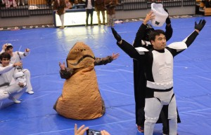 Junior Brian Sloan, who played Darth Vader in the juniors' spirit week skit, lifts the helmet off of a Storm Trooper, revealing junior dean Mr. Hatori. Photo: Fred Assaf