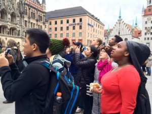 Pace students admire the renowned glockenspiel atop the City Hall performing its elaborate dance. Photo: Mr. Smith