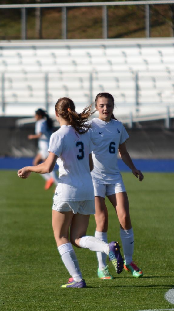 Seniors Cadie Schiffer and Cater Carlton celebrate another goal. Credit: Fred Assaf