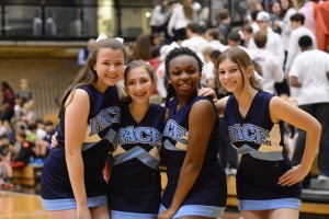 Freshmen Kendall Willis, Allison Reish, Alex Allen, and sophomore Anna Stone cheer on the Varsity Basketball team. Photo Credit: Fred Assaf