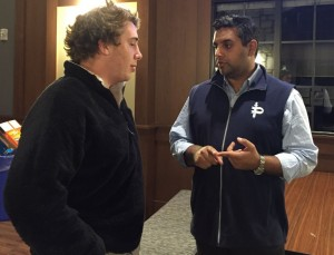 Faraz advises participant Ben Siegel on some marketing tips for his product. Photo: Sloan Wyatt