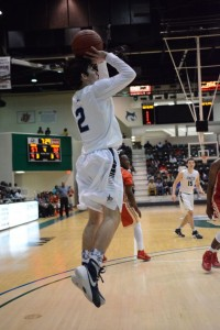 Junior Barrett Baker lines up a jump shot in the third quarter of an Elite Eight matchup against Thomasville. Baker, a junior, finished with 17 points on the night. Photo: Fred Assaf