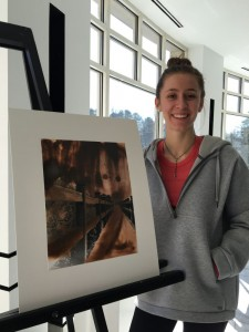 Senior Elizabeth Hawn showing off her favorite photography piece. Photo: Amy Butler
