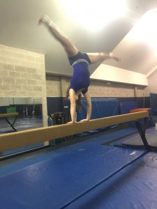 Junior Emma Downey performs on the balance beam.