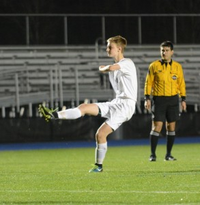 Sophomore center-back Nate Reece shoots his penalty shoot during last year's penalty kicks against Holy Innocents'