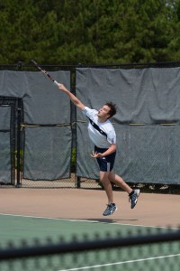 Junior Josh Nash hits a powerful serve. Photo: Fred Assaf