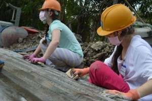 Junior Emma Downey and Senior Tory Dancu work hard on the build site in My Tho. Photo: Caitlin Jones