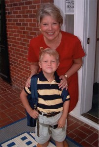 A young Joe Loughran poses with former LS Principal Anna Valerius on his first day of school, 2004. Photo: Joe Loughran