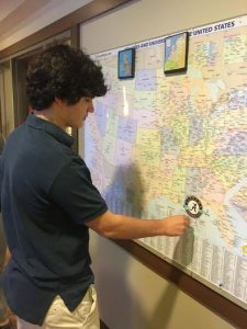 Senior Caleb Levin puts his flag on the map indicating that he will attend The University of Alabama.