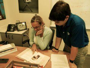 Mrs. Wilhemsen helps her ninth grade math students get through their first year of high school. Photo: Genna Schwarz