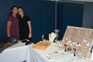 Seniors Katy Leitz and Molly Jacoby sold jewelry at the 2015 Fall Fair. Photo: Yearbook