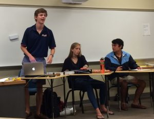 Student body president Chris Howard (standing) leads the weekly Student Council meeting, held every Wednesday. Photo: Amy Butler