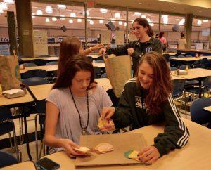 Freshmen Ada Jane Agoli and Lucy Ferry make sandwiches for the Zaban Paradeis Center. Photo: Genna Schwarz