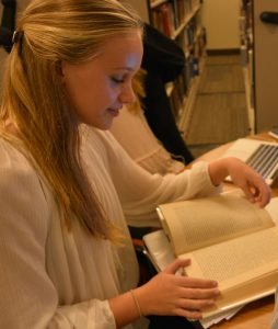 Sophomore Paige Fleming reads her favorite book.