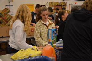 Sophomore Lily Wagoner helps sort food at the Atlanta Community Food Bank on Service Day a year ago. Photo: Lee Wilson