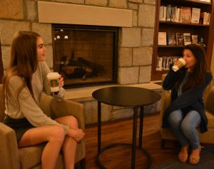 Juniors Grace Dwyer and Nicole Ortiz enjoy Starbucks drinks and each others' company.