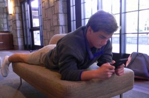 Junior Graeme Davidson spends his free time on his phone. Photo: Anna Stone